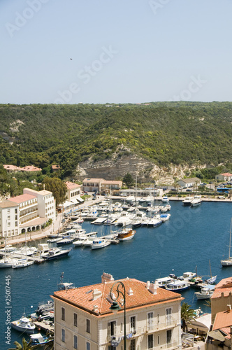 panorama Bonifacio Corsica harbor port with yachts historic lowe