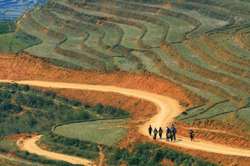 Traveller and hmong villager walk at Curve Dirt road in Sapa