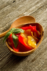 pepper preserved on bowl  with spoon
