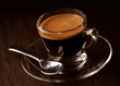 Espresso coffee on brown background
