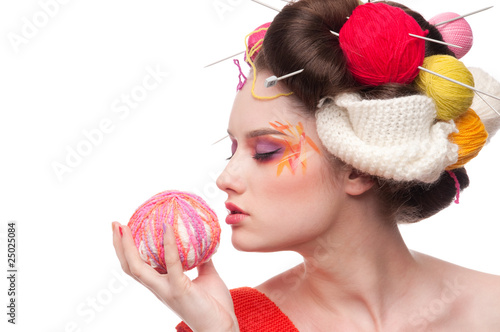 Closeup fashion woman with color face art in knitting style