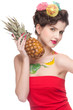 Close up portrait of beauty woman with fruit bodyart and pineapp