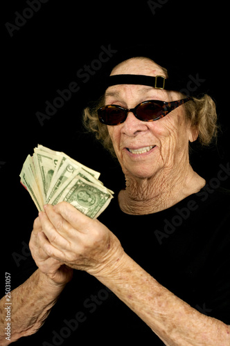 Portrait of an old woman holding a lot of cash