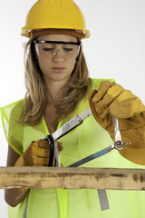 A Teenage Girl Learning To Use A Saw