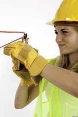 Construction Girl Cutting A Red Wire