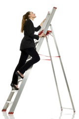 young businesswoman on a scale on white background studio