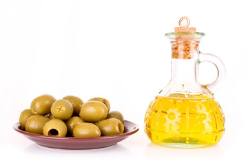 Olives and a bootle of oil isolated on white