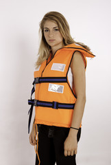 A Young Girl Wearing A Life Vest