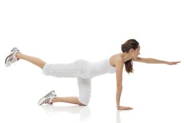 Young woman doing gymnastics on white background studio