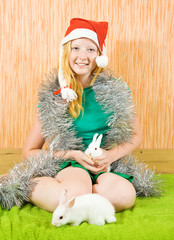 girl in santa hat  with  abbits