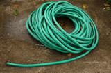 Roll of green water hose
