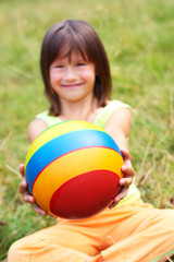 The child hold a ball