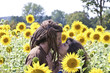 Young Couple in love kissing in sunflower field.
