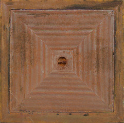 rusty metal square shaped seal for a sewer pit