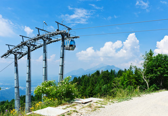 Cable car over alpine forest. Empty mountain bike elevator.