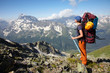 Hiker girl with backpack and ice-axe
