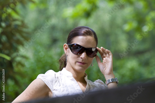 canvas print picture Female portrait in the park with sunglasses
