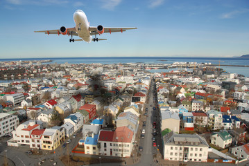 Airplane above Reykjavik city