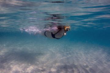 Woman swimming the Sea
