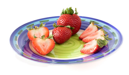 strawberries on a plate isolated on white