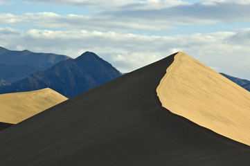 Sand Dune and Mountain Peaks