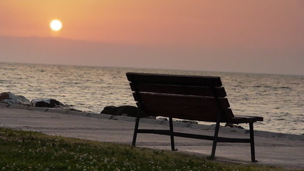 Bench by sea at sunset - Nature - Leisure