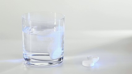 Effervescent tablet dissolving in glass with water