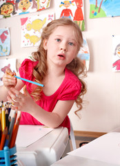 Child with colorful pencil .