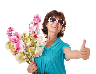 Senior woman holding bunch of flowers.