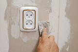 putty near wall outlet poster