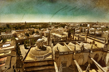 Great view of roofs in Seville town in grunge and retro style