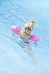 Girl in a swimming-pool