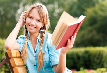 beautiful young student girl reading book