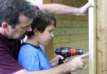 boy using drill