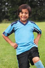 Young boy in blue soccer uniform portrait