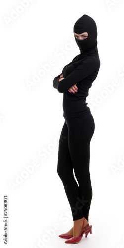 female thief in balaclava  with crossed arms