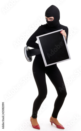 criminal woman in balaclava with screen of computer