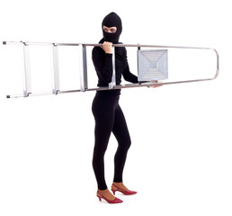 female thief in black balaclava keeping ladder