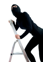 female thief in balaclava entering on ladder