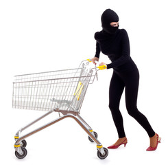 thief in black clothes and balaclava with shopping cart
