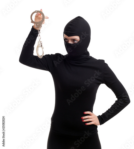 female thief in black balaclava keeping handcuffs