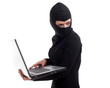 female criminal in balaclava with the laptop