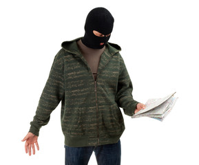 thief in dark clothes and black balaclava with map