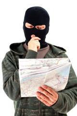 thief in black balaclava with map