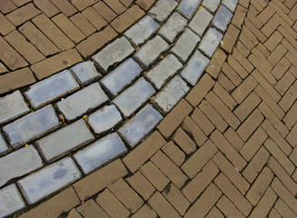 brown brick pavement with gray blue cobble stone in between