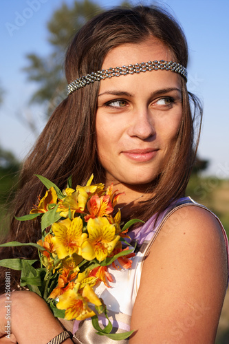 Hippie girl with lily outdoors