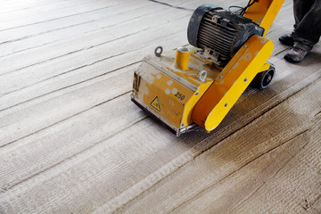 machine removing the surface of a concrete floor