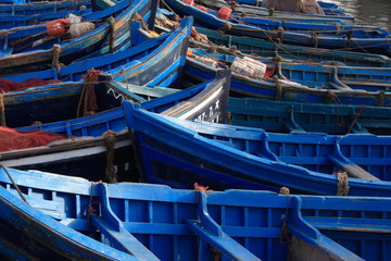Blue wooden fishing boats at the harbour