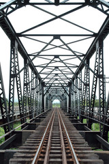 The railway bridge through the river of Thailand