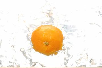 Single orange splashing in water